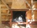 Tour de cheminée en chêne façon colombage.