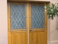 Porte en chêne teintée et vernis