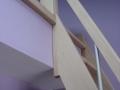 Détail d'escalier de mezzanine en hêtre.